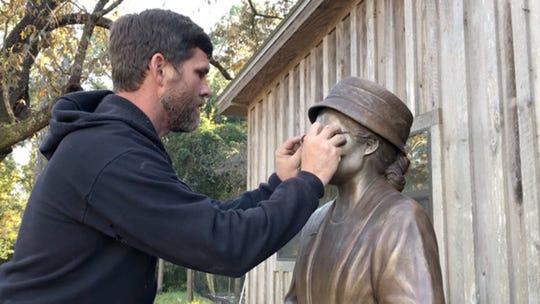 """Clydetta Fulmer: """"When the patina was completed, then the statue was waxed. The final touch was to add the bronze glasses. Corey Swindle had to make the bronze rims wider than the rims that were almost invisible that Rosa Parks wore that day. He had to do this so that the glasses would not be easily broken."""""""