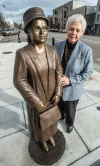 Montgomery artist Clydetta Fulmer is shown with her lifesize bronze statue of Rosa Parks, on permanent display at the end of Dexter Avenue, looking toward the Court Square Fountain.