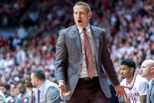 Alabama head coach Nate Oats yells in to this players during the second half of an NCAA college basketball game against Auburn, Wednesday, Jan. 15, 2020, in Tuscaloosa, Ala. Alabama upset No. 4 Auburn 83-64. (AP Photo/Vasha Hunt)