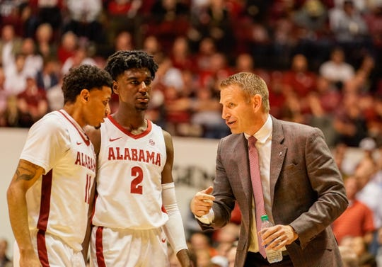 Jan 15, 2020; Tuscaloosa, Alabama, USA; Alabama Crimson Tide head coach Nate Oats talks to guard James Bolden (11) and  guard Kira Lewis Jr. (2) during a timeout against Auburn Tigers at Coleman Coliseum. Mandatory Credit: Marvin Gentry-USA TODAY Sports