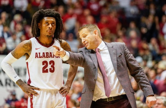 Jan 15, 2020; Tuscaloosa, Alabama, USA; Alabama Crimson Tide head coach Nate Oats directs his player guard John Petty Jr. (23) during the game against Auburn Tigers at Coleman Coliseum. Mandatory Credit: Marvin Gentry-USA TODAY Sports