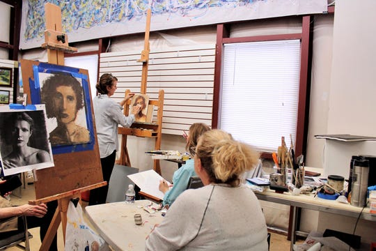 Artists work at the Pike Road Arts Center. The center will be the site of a monthlong art show that starts Jan. 23.