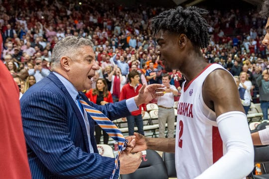 Auburn coach Bruce Pearl shakes hands with Alabama guard Kira Lewis Jr. after a game on Wednesday, Jan. 15, 2020, in Tuscaloosa, Ala.