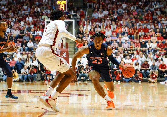Jan 15, 2020; Tuscaloosa, Alabama, USA;  Auburn Tigers forward Isaac Okoro (23) drives to the basket against Alabama Crimson Tide forward Herbert Jones (1) at Coleman Coliseum. Mandatory Credit: Marvin Gentry-USA TODAY Sports