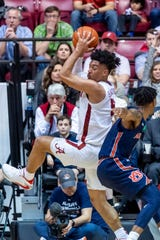 Alabama guard Jaden Shackelford (5) grabs a rebound over Auburn guard Jamal Johnson (1) during the second half of an NCAA college basketball game, Wednesday, Jan. 15, 2020, in Tuscaloosa, Ala. Alabama upset No. 4 Auburn 83-64. (AP Photo/Vasha Hunt)