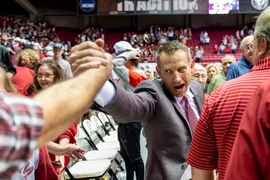 Alabama coach Nate Oats celebrates with the fans after his first win over rival Auburn, in an NCAA college basketball game Wednesday, Jan. 15, 2020, in Tuscaloosa, Ala. (AP Photo/Vasha Hunt)