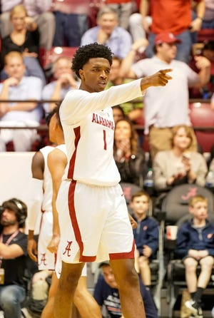 Jan 15, 2020; Tuscaloosa, Alabama, USA; Alabama Crimson Tide forward Herbert Jones (1) points to his bench after a play during the game against Auburn Tigers at Coleman Coliseum. Mandatory Credit: Marvin Gentry-USA TODAY Sports
