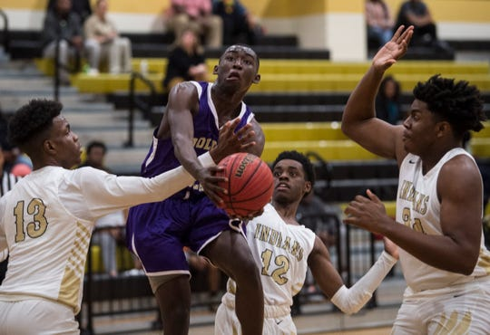 BTW-Tuskegee's James Perry (4) is fouled by Wetumpka's Joshua Landry (13) at Wetumpka High School in Wetumpka, Ala., on Thursday, Jan. 16, 2020.