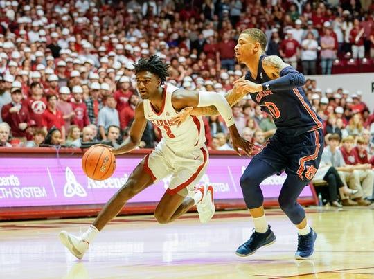 Alabama Crimson Tide guard Kira Lewis Jr. (2) drives to the basket against Auburn guard Samir Doughty (10) at Coleman Coliseum on Jan. 15, 2020.