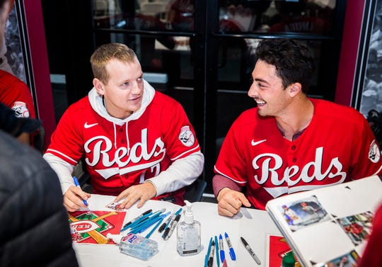 Josh VanMeter and Jonathan India sign autographs during the Reds Caravan at Stoops Automotive.