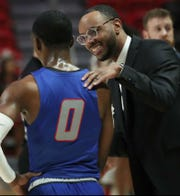 """Second-year Tennessee State basketball coach Brian """"Penny"""" Collins talks with senior guard Michael Littlejohn."""