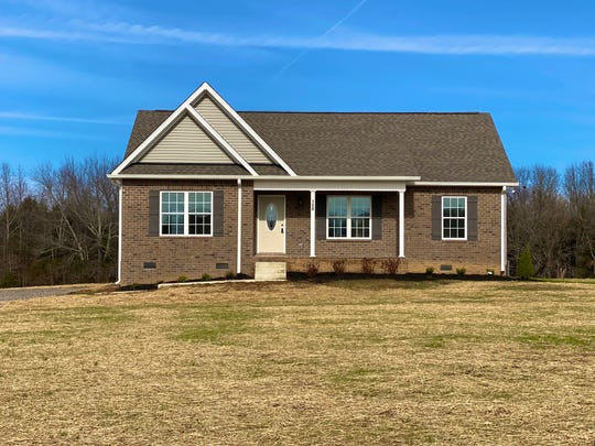 This home for sale in Portland's Oak Drive Estates subdivision has granite countertops and wood-look luxury vinyl flooring. Portland's prices are lower than many other Nashville-region locations.