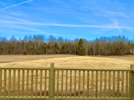Homes in Oak Drive Estates have one-acre yards, which helps ensure privacy. This is the view from the rear deck.