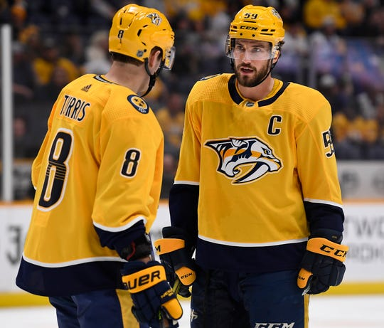 Predators defenseman Roman Josi (59) talks with center Kyle Turris (8) as they wait for a face-off against the Anaheim Ducks during the third period at Bridgestone Arena Thursday, Jan. 16, 2020 in Nashville, Tenn.
