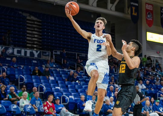 FGCU guard Caleb Catto goes up for a layup against Kennesaw State on Thursday, Jan. 16, 2020 at Alico Arena.