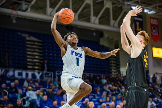 FGCU guard Zach Scott goes up for a layup against Kennesaw State on Thursday, Jan. 16, 2020 at Alico Arena.