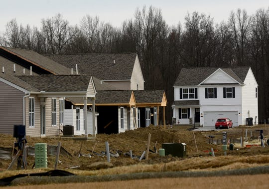 Completed and in progress homes nestled together in the new Broadmoore Commons subdivision off Broad Street (Ohio 16), between Summit Road SW and Mink Street SW. Licking County's population is expected to continue growing over the next two decades.