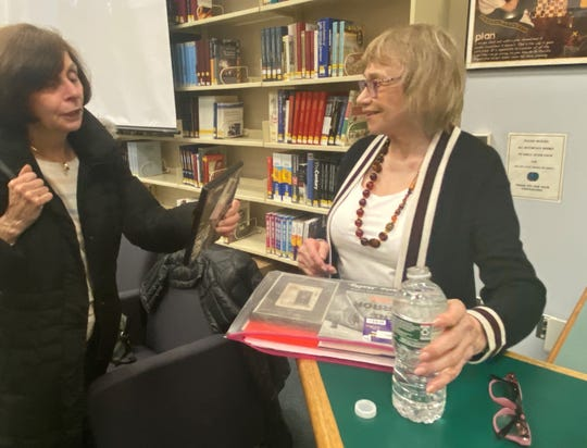 Holocaust survivor Frances Malkin, right, talks to an audience member after speaking at Glen Rock High School Jan. 15, 2020.