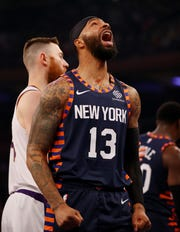 Marcus Morris Sr. #13 of the New York Knicks reacts after drawing the foul in the first half against the Phoenix Suns at Madison Square Garden on January 16, 2020 in New York City.