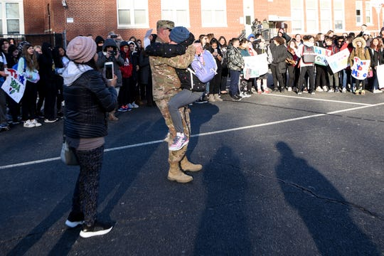 Michael Mills, a U.S. soldier who was stationed in Kuwait, surprises his daughter, Harley Mills, at Haskell Elementary School in Haskell on Friday January 17, 2020.