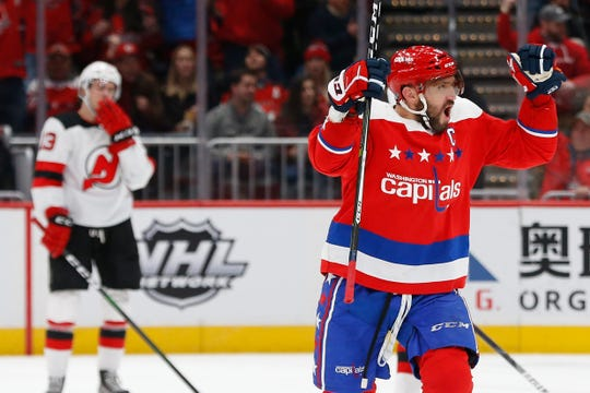 Jan 16, 2020; Washington, District of Columbia, USA; Washington Capitals left wing Alex Ovechkin (8) celebrates after scoring a goal against the New Jersey Devils in the first period at Capital One Arena.