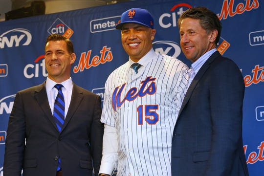 Carlos Beltran stands between General Manager Brodie Van Wagenen and COO Jeff Wilpon after being introduced as manager of the New York Mets during a press conference at Citi Field on November 4, 2019 in New York City.