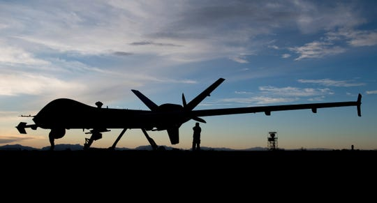 Airmen from the 29th Aircraft Maintenance Unit check over the first MQ-9 Reaper to be transported through ferry flight here, Jan. 8, 2020, on Holloman Air Force Base. Transporting remotely piloted aircraft from California meant using the National Airspace System and required extra documentation to permit the flight.