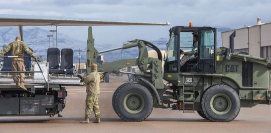 Airmen from the 49th Logistics Readiness Squadron Deployment and Distribution Flight unload passenger seating from a KC-10 Extender to make room for other cargo on Holloman Air Force Base, N.M, Jan. 10, 2020. The 49th LRS Deployment and Distribution Flight plays a huge role in making sure Airmen here are ready to deploy when they are called upon. (U.S. Air Force photo by Staff Sgt. Timothy Young)