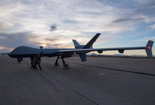 Airmen from the 29th Aircraft Maintenance Unit look over the 49th Wing's newest MQ-9 Reaper, Jan. 8, 2020, on Holloman Air Force Base, N.M. This is the first remotely piloted aircraft to be ferried through the National Airspace to Holloman.