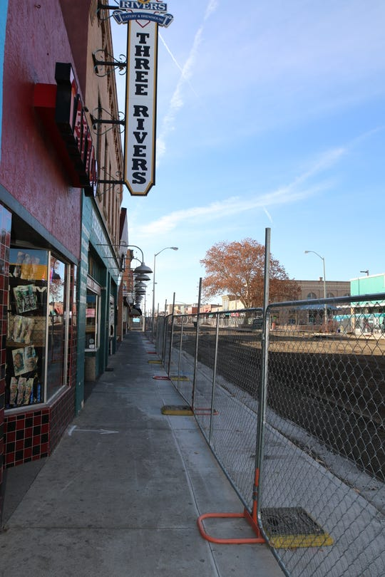 The management team at the Three Rivers Brewery enterprises is trying to convince city officials to open a pedestrian corridor through the Complete Streets work zone in downtown Farmington.