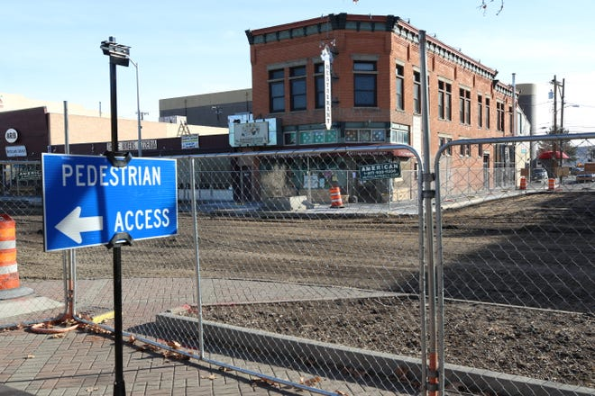 A cyclone fence encircles a three-block stretch of Main Street through downtown Farmington, including this section in front of the Three Rivers Brewing block, as work on the Complete Streets project continues.
