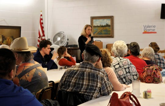 Au audience listens as Valerie Plame speaks, Tuesday, Jan. 14, 2020, during a campaign visit to Farmington
