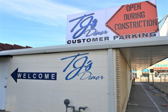 TJ's Diner owner Nathan Hill has posted signage on the back of his business alerting customers about where they can park and how they can enter his business from the rear.