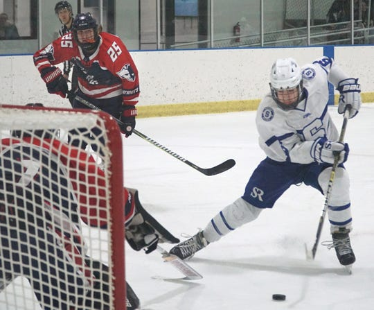 Salem Rock forward Alex Mazzuca skates in on Franklin goalie Steven Hicks.