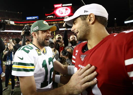 Green Bay Packers quarterback Aaron Rodgers greets San Francisco 49ers quarterback Jimmy Garoppolo after their Nov. 24 game at Levi's Stadium oin Santa Clara, Calif.