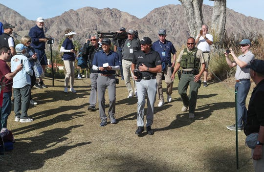 Ben Ramirez, right, of the Riverside County Sheriff's Department walks with Phil MIckelson on the Nicklaus Course of PGA West in La Quinta, during the American Express golf tournament, January 17, 2020. Ramirez has been assigned to Mickelson's group about a dozen times through the years.