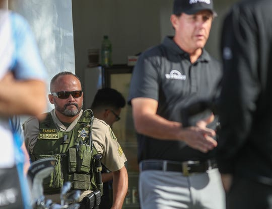 Ben Ramirez of the Riverside County Sheriff's Department keeps an eye on things as Phil MIckelson gets ready to tee off at the Nicklaus Course of PGA West in La Quinta, during the American Express golf tournament, January 17, 2020. Ramirez has been assigned to Mickelson's group about a dozen times through the years.