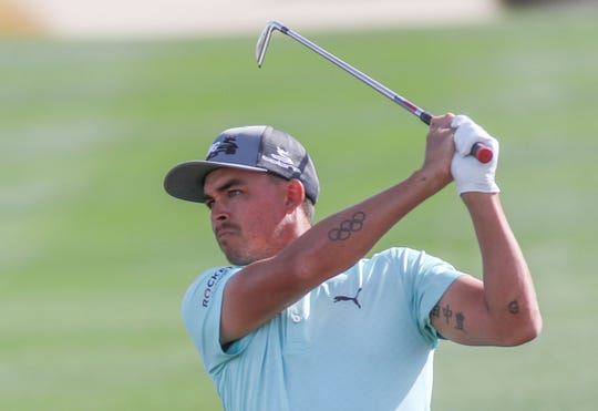Rickie Fowler hits an approach shot on the 18th hole at the Nicklaus Course of PGA West in La Quinta, during the American Express golf tournament, January 17, 2020.