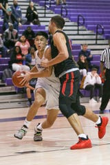 Shadow Hills High School's Dominic Escobar drives the ball against Palm Springs on Thursday night. Palm Springs won 55-53.