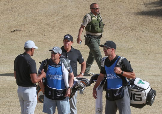 Ben Ramirez, top, of the Riverside County Sheriff's Department keeps an eye on things as Phil MIckelson and Tony Finau play at the Nicklaus Course of PGA West in La Quinta, during the American Express golf tournament, January 17, 2020.  Ramirez has been assigned to Mickelson's group about a dozen times through the years.