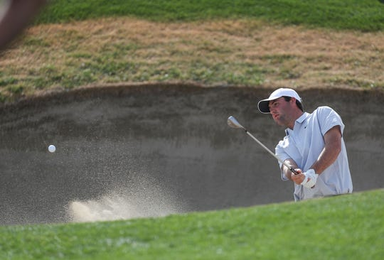 Scottie Scheffler hits out of the bunker on the 18th hole at the Nicklaus Tournament Course at PGA West in La Quinta, during the American Express golf tournament, January 17, 2020.