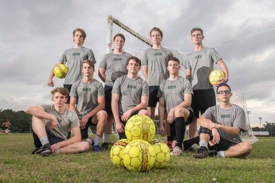 East Hill Christian boy's soccer players (top left to right) Jacob Dickson, Noah Dickson, John Graves, Luke Seelmann, (bottom left to right) Isaiah Waters, Malachi Waters, John Coltrane, Buddy Hubbard, and Memphis Jocson pose at Ashton Brosnaham Park in Pensacola on Thursday, Jan. 16, 2020.  This is the team's first season in FHSAA.
