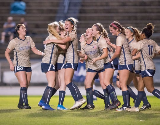 The Dolphins celebrate taking a 3-2 lead during the Navarre vs Gulf Breeze girls soccer game at Gulf Breeze High School on Thursday, Jan. 16, 2020.