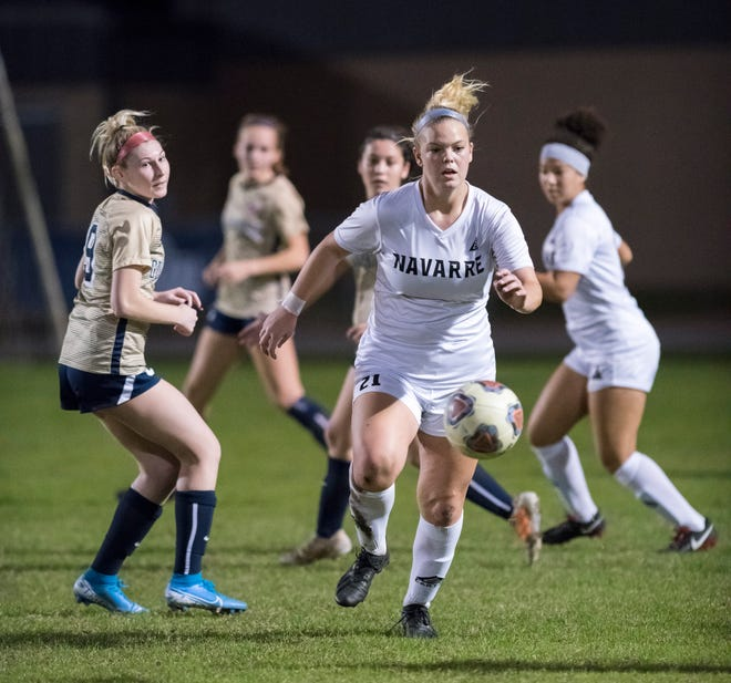Hunter Wallace (21) chases down the ball during the Navarre vs Gulf Breeze girls soccer game at Gulf Breeze High School on Thursday, Jan. 16, 2020.