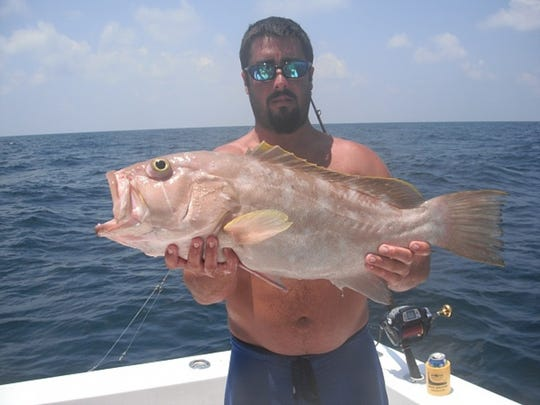 Daniel Scallan of Gulf Breeze with a yellowedge grouper he caught deep dropping.