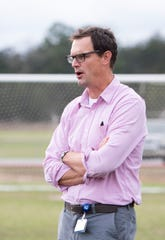 Head coach Rudy Seelmann watches as the East Hill Christian boy's soccer team practices at Ashton Brosnaham Park in Pensacola on Thursday, Jan. 16, 2020.  This is the team's first season in FHSAA.