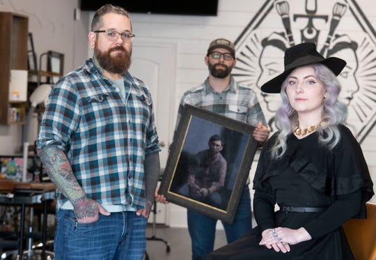 From left, DJ Minor, Loren Miller and Felix Duette Minor pose for a photo Friday at Three Fates Studio, a longtime tattoo studio and art gallery that has relocated to 7 E. Gregory St.