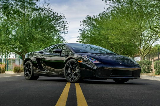 This triple-black Lamborghini Gallardo coupe features silver brake calipers and large factory rotors, an advanced radar system and all-wheel drive.