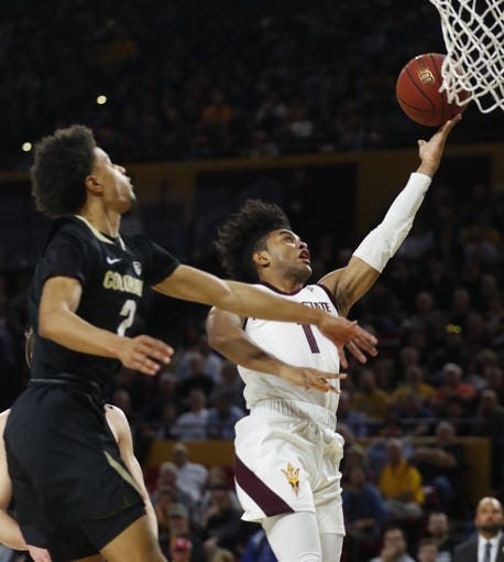 ASU's Remy Martin (1) makes a layup against Colorado's Dayton Kountz (2) during the first half at Desert Financial Arena in Tempe, Ariz. on January 16, 2020.