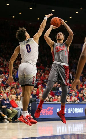 Jan 16, 2020; Tucson, Arizona, USA; Utah Utes forward Timmy Allen (1) shoots against Arizona Wildcats guard Josh Green (0) in the first half at McKale Center. Mandatory Credit: Jacob Snow-USA TODAY Sports